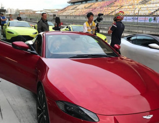 Taking guests on hot laps in the brand new Aston Martin